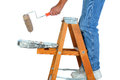 Closeup painter standing ladder roller dripping paint man unrecognizable white background Stock Image