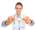 Closeup on patch in hand of doctor woman Royalty Free Stock Photo