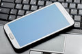 Closeup of a phablet on laptop Royalty Free Stock Photo