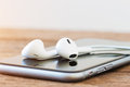 Closeup phone and headphone device on table Royalty Free Stock Photo