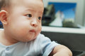 Closeup photo of beautiful cute asian baby expression s Stock Photos
