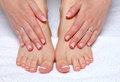 Closeup photo of a beautiful female feet with red pedicure isolated on white Royalty Free Stock Photo