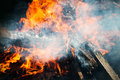 Closeup photo of big outdoor bonfire with smoke Stock Image
