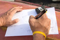 Closeup photo of drawing and carpenter's hands who is going to make design Royalty Free Stock Photo