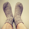 Closeup photo of male feet with woolen socks gray Royalty Free Stock Photos