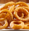 Closeup photo of a pile of onion rings Stock Photo