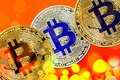 Physical version of Bitcoin new virtual money with colorful effect Royalty Free Stock Photo