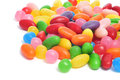 Closeup of a pile of jelly beans of different colors on a white background Royalty Free Stock Images