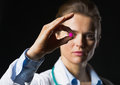 Closeup on pill in hand of doctor woman on black background Royalty Free Stock Photo