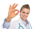 Closeup on pill in hand of happy doctor woman Royalty Free Stock Photo