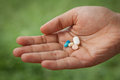 Closeup pills on woman hand Royalty Free Stock Photo