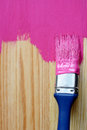 Closeup of pine plank being painted in a bright colour with copy space Stock Photos