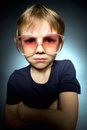 Closeup portrait Angry young Boy with big glasses Royalty Free Stock Photo