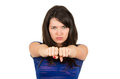 Closeup portrait of angry young girl posing with beautiful fists in front isolated on white Royalty Free Stock Images