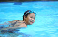 Closeup portrait of asian little swimmer girl smile in siwmmingpool Stock Image