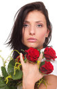 Closeup portrait of attractive young woman holding a red rose Stock Photography