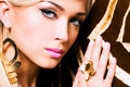 Closeup portrait beautiful face sexy woman fashion makeup gold ring finger Royalty Free Stock Photo