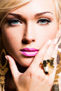 Closeup portrait beautiful face sexy woman fashion makeup gold ring finger Stock Photo