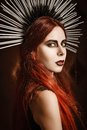 Closeup portrait of beautiful gothic girl wearing spiked headgear Royalty Free Stock Photo
