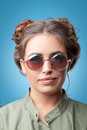 Closeup portrait of beautiful trendy hipster girl with hair buns Royalty Free Stock Photo