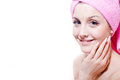 Closeup portrait of beautiful young attractive girl blue eyes blond woman with pink towel happy smiling looking at camera on white Royalty Free Stock Image