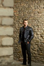 Closeup portrait brutal young sexual man leather jacket Stock Photos