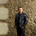 Closeup portrait brutal young sexual man leather jacket Stock Image