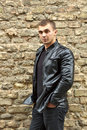Closeup portrait brutal young sexual man leather jacket Royalty Free Stock Photography