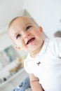 Closeup portrait of a cheerful cute baby over blurred background Stock Photos