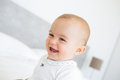 Closeup portrait of a cheerful cute baby over blurred background Stock Photography