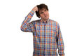 Closeup portrait of confused young man in checkered shirt. Royalty Free Stock Photo