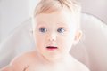 Closeup portrait of cute adorable funny blonde Caucasian smiling laughing baby boy girl with blue eyes with emotional face Royalty Free Stock Photo