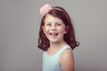 Brunette Caucasian preschool girl looking in camera. Child smiling laughing posing in studio Royalty Free Stock Photo