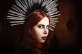 Closeup portrait of cute gothic girl wearing spiked headgear Royalty Free Stock Photo