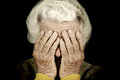 Closeup portrait depressed old woman covering her face with hand Royalty Free Stock Photo