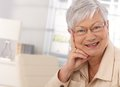Closeup portrait of elderly woman looking at camera smiling Stock Photography