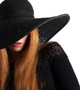Closeup portrait of a fashion model in black hat isolated on white Royalty Free Stock Photos