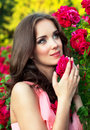 Closeup portrait of a girl on a background of roses Royalty Free Stock Photo