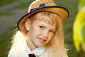 Closeup portrait of girl smiling cute in straw hat outdoor Royalty Free Stock Photos
