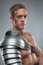 Closeup portrait of Gladiator in armour over grey Royalty Free Stock Photo