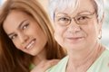 Closeup portrait of happy mother and daughter senior young hugging smiling Stock Photography