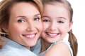 Closeup portrait of happy mother and young daughter white isolated family people concept Stock Photo