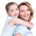 Closeup portrait of happy mother and young daughter white isolated family people concept Stock Image