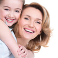 Closeup portrait of happy mother and young daughter white isolated family people concept Royalty Free Stock Images