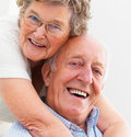 Closeup portrait of a happy older couple hugging Royalty Free Stock Image