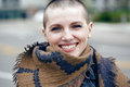 Closeup portrait of happy smiling laughing beautiful Caucasian white young bald girl woman with shaved hair head