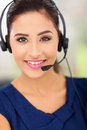 Closeup portrait happy young call centre employee smiling headset Royalty Free Stock Image