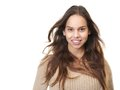 Closeup portrait of a happy young woman smiling close up with hair blowing isolated on white Royalty Free Stock Photo