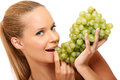 Closeup portrait of a healthy woman bites in grape Stock Images