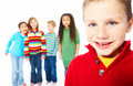 Closeup portrait of kid with friends Stock Photos
